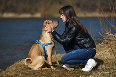 Girl with dog in the park Royalty Free Stock Images