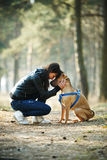 Girl with dog in the park Stock Photography