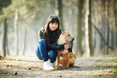 Girl with dog in the park Stock Images