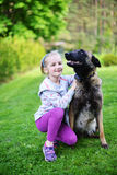 Girl and dog. Girl playing with dog on grass Stock Images