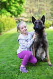 Girl and dog. Girl playing with dog on grass Stock Photography