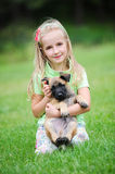 Girl with dog. Girl playing with dog on grass Royalty Free Stock Photos
