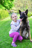 Girl and dog. Girl playing with dog on grass Stock Photo