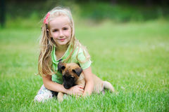 Girl with dog. Girl playing with dog on grass Stock Photography
