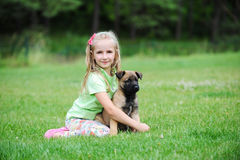 Girl with dog. Girl playing with dog on grass Royalty Free Stock Photo