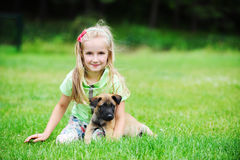 Girl with dog. Girl playing with dog on grass Stock Photos