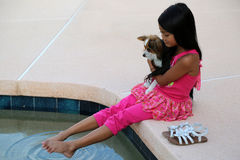 Girl With Dog By Pool Stock Photography