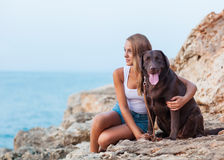 Girl with a dog. Portrait of a woman with her beautiful dog sitting outdoors Royalty Free Stock Image