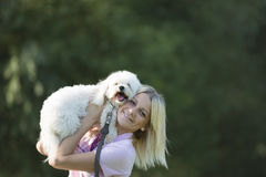 Girl and dog. Portrait of a young girl with her dog Stock Image