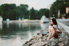 Girl with a dog on the promenade Royalty Free Stock Image