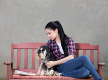 Girl with dog reading a book Royalty Free Stock Photos