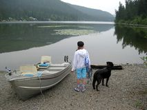 Girl and dog ready to go boating Royalty Free Stock Photo