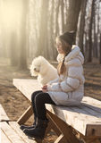 Girl and a dog  by the river Royalty Free Stock Image