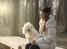 Girl and a dog  by the river Stock Images