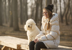 Girl and a dog  by the river Stock Photos