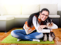 Girl with dog in the room Royalty Free Stock Images