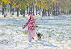 Girl and dog running Stock Images