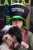 Girl with dog at Saint Patrick s Day Stock Images