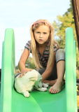 Girl with dog on slide Royalty Free Stock Photos