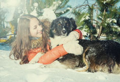 Girl with a dog in the snow. Royalty Free Stock Photo