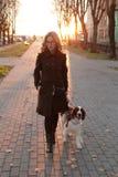 Girl with a dog. On the street stock photos