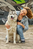 Girl with a dog on the street royalty free stock image