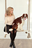 Girl with a dog. On the swing royalty free stock photography