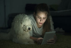 Girl, dog and tablet Royalty Free Stock Photography