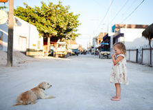 Girl and dog at town Stock Photos