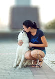 Girl with the dog for a walk Royalty Free Stock Photo