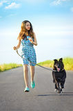 Girl with a dog for a walk Royalty Free Stock Photos