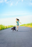 Girl with a dog for a walk Stock Photo