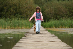 Girl and dog walking Royalty Free Stock Images
