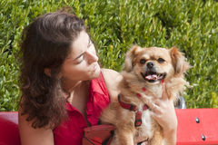 Girl with dog walking on the park. Royalty Free Stock Images