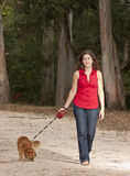 Girl with dog walking on the park. Royalty Free Stock Image