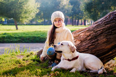 Girl and dog. Girl walking in the park with a  labrador Royalty Free Stock Photos
