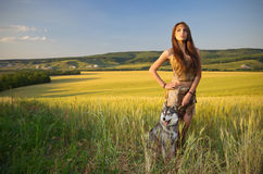 Girl with dog  in a wheat field Stock Image