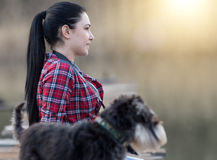 Girl with dog on wooden dock Stock Photo