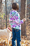 Girl and Dog in the Woods Stock Image