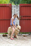 Girl on a dog Stock Image
