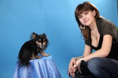 The girl with the doggie on a blue background Stock Image