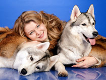 Girl with a dogs Royalty Free Stock Image
