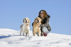 Girl with dogs. Young girl with two dogs in the mountain Royalty Free Stock Photography
