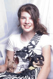 Girl with dogs in a bag. Smiling young girl with a bag with two dogs inside Royalty Free Stock Images