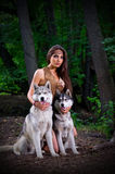 Girl with dogs at forest Royalty Free Stock Image