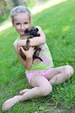 Girl  with dogs. Girl playing with dogs on grass Stock Images