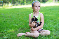 Girl  with dogs. Girl playing with dogs on grass Royalty Free Stock Images