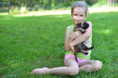 Girl  with dogs. Girl playing with dogs on grass Royalty Free Stock Photography