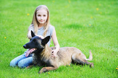 Girl  with dogs. Girl playing with dogs on grass Royalty Free Stock Photos