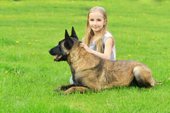 Girl  with dogs. Girl playing with dogs on grass Royalty Free Stock Image